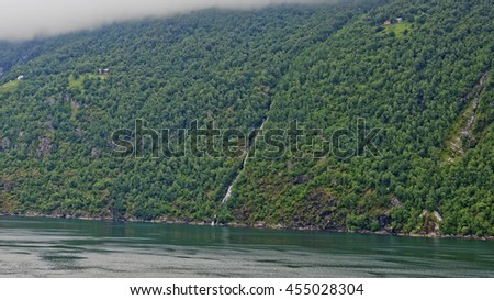 Early morning view under solid low clouds of the beautiful Geiranger Fiord in Norway