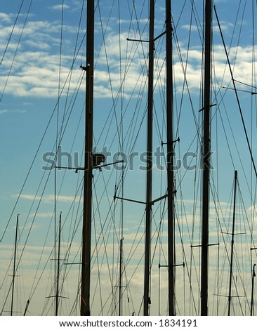 Early morning. Yachts yet do not send in the sea. Silhouettes of masts in port. Romantic photo - stock photo