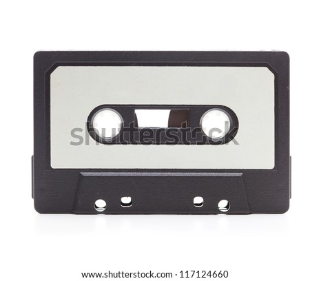 Early 70's cassette tape isolated on white with slight reflection. White blank label. - stock photo