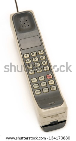 Early 1990's Style Mobile Phone. One of the first models ever made. Isolated on white background. - stock photo