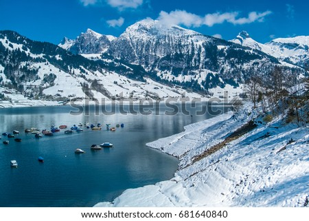 Early spring snow-covered landscapes around the Wagital lake (Wagitalersee) in the Wagital valley in the canton of Schwyz, Switzerland