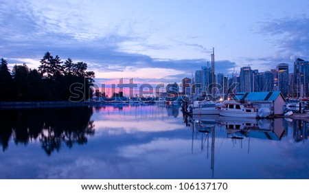Early sunrise light on a marina in Stanley Park, Vancouver, British Columbia. - stock photo