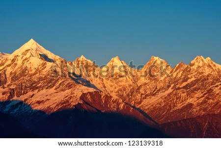 early sunset over Panchachuli Peaks in Indian Himalayas - stock photo