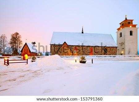 Early 15th-century stone church is heart Church Village of Gammelstad, Lulea, Sweden. - stock photo