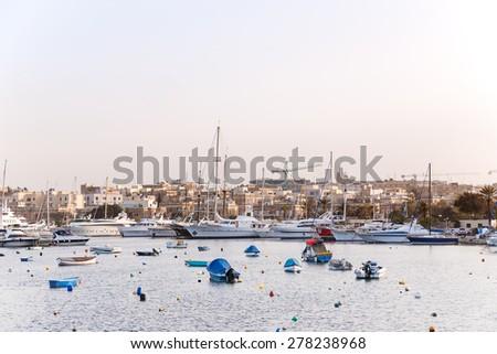 Early winter morning at Marsamxett harbour. Many sailing yachts lie alongside. Valletta, Malta.  - stock photo