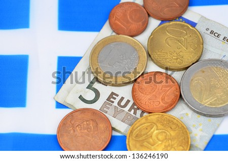 Earning in Greece concept with Euro money and flag - stock photo