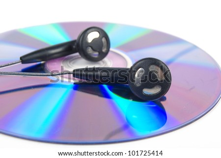 Earphone and DVD - stock photo