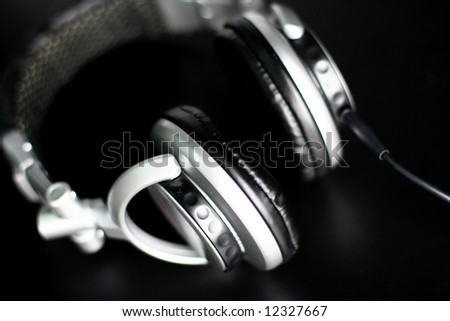 Earphones on black - stock photo