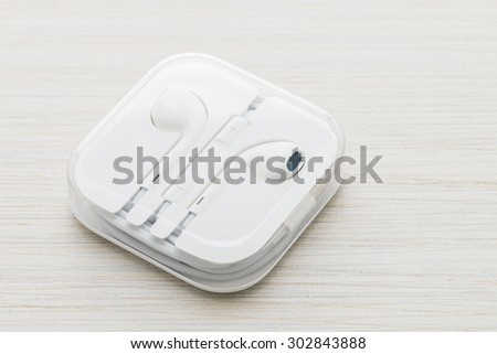 Earphones on wood background