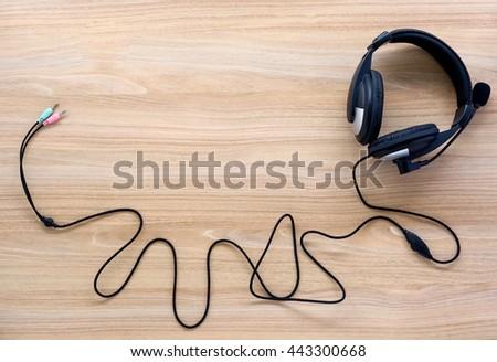 earphones on wood board - stock photo