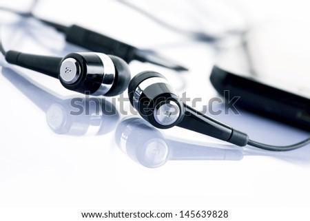 earphones with mobile smartphone - stock photo