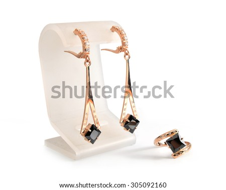 earrings and ring isolated on white background - stock photo