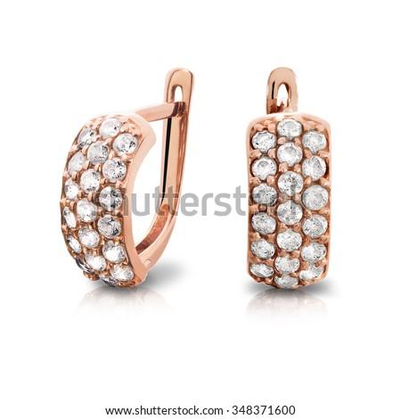 Earrings. Gold earrings with diamonds. Jewelry - stock photo
