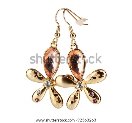 Earrings in the form of a flower with a yellow stone isolated on white - stock photo