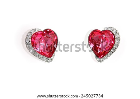 Earrings in the shape of heart isolated on white background - stock photo
