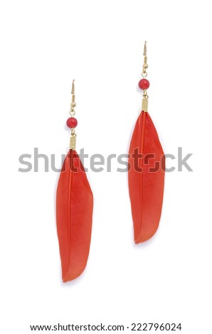 earrings with red feathers on a white background - stock photo