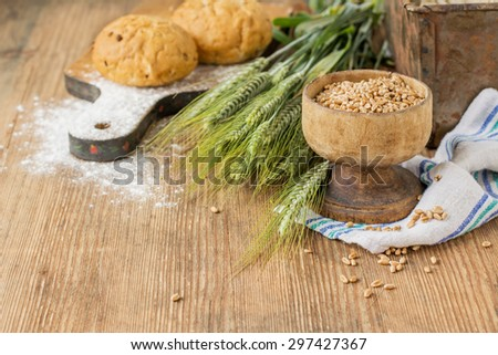 Ears Of Barley Flour Bread On A Wooden Background Selective Focus
