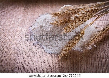 ears of rye little heap of flour on wooden board food and drink concept  - stock photo