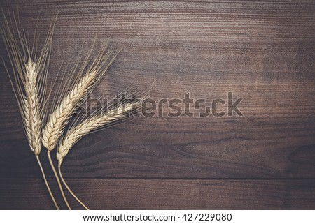ears of rye on the wooden background