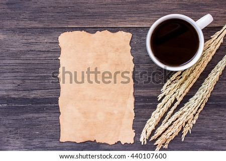 Ears of wheat and old paper with cup of coffee on dark wooden table background. top view with copy space - stock photo