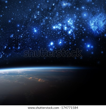 Earth and galaxy. Elements of this image furnished by NASA. - stock photo