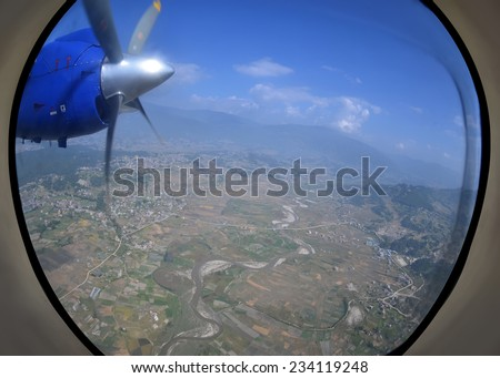 Earth and sky - view from an illuminator - stock photo