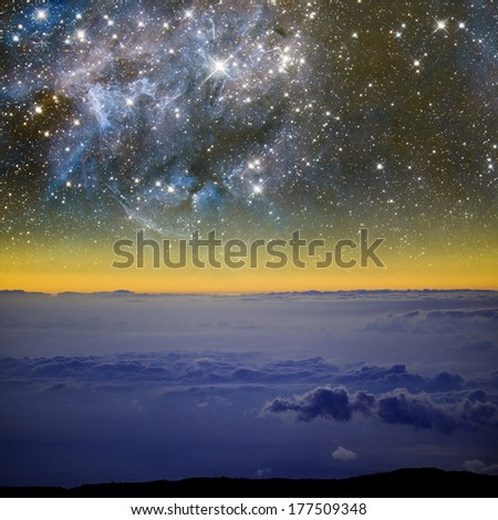 Earth and space above the clouds. Elements of this image furnished by NASA. - stock photo