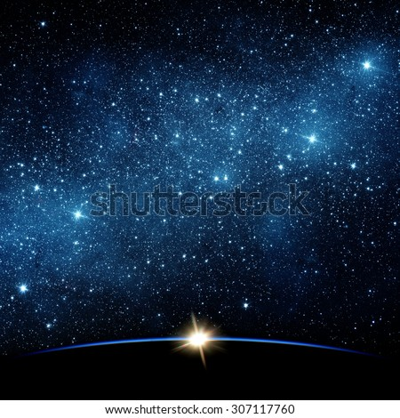 Earth and star. Elements of this image furnished by NASA. - stock photo