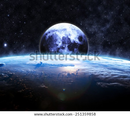 Earth and the Moon - Elements of this Image Furnished by NASA - stock photo