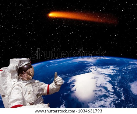 Earth, astronaut and comet. The elements of this image furnished by NASA.