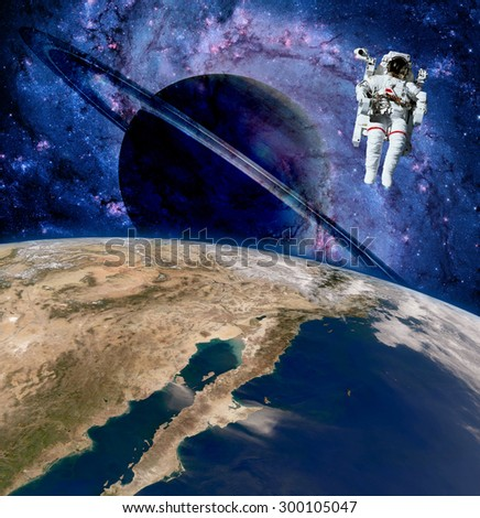 Earth astronaut planet outer space saturn spaceman cosmonaut. Elements of this image furnished by NASA.
