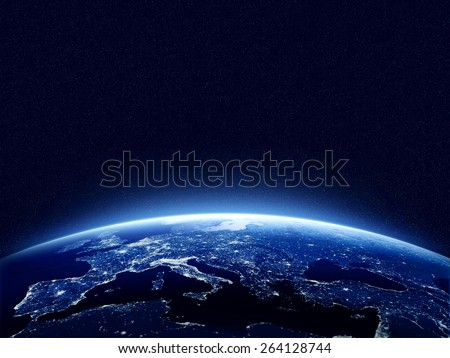 Earth at night as seen from space with blue, glowing atmosphere and space at the top. Perfect for illustrations.  Elements of this image furnished by NASA - stock photo