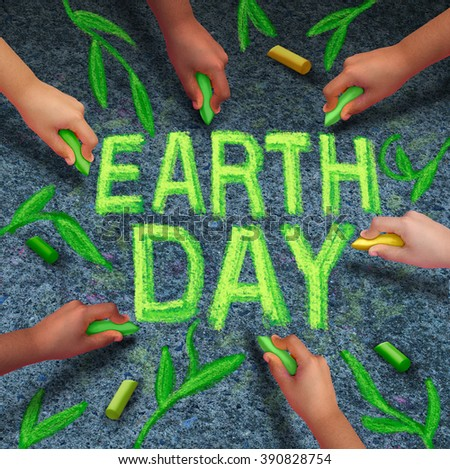 Earth day and environmental protection symbol as a group of diverse ethnic people coming together drawing text and leaves with green chalk on pavement as a global community collaboration. - stock photo