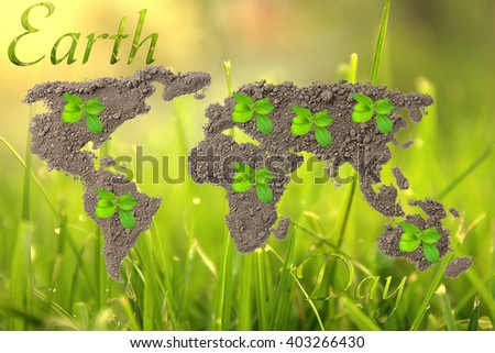 Earth Day. Concept ecology. World map, globe from the soil with green plants around the world on natural background - stock photo