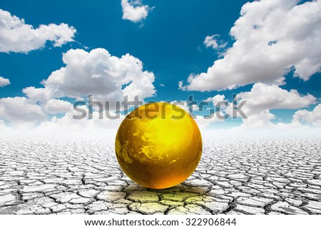Earth day concept . Golden world ball on the soil cracked.Elements of this image furnished by NASA - stock photo