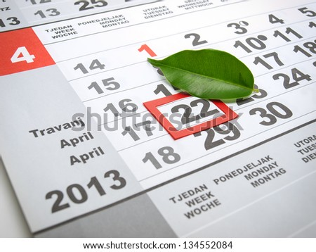 Earth day marked on the calendar with a leaf as a symbol. - stock photo