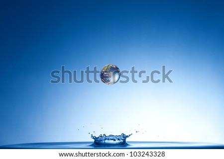 earth falling into the water - stock photo