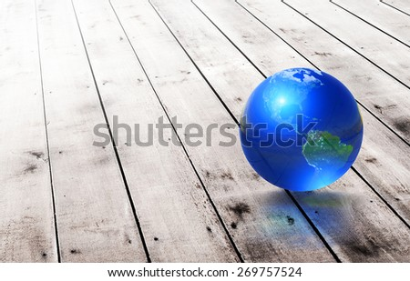 Earth glass ball  on old wood background .Earth day concept.Elements of this image furnished by NASA - stock photo