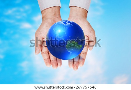 Earth glass ball  on two hamd and on blue sky background .Earth day concept.Elements of this image furnished by NASA - stock photo