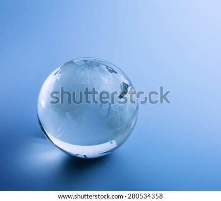 Earth glasses, isolated on blue background - stock photo