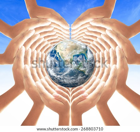 Earth globe in hands for heart shape over blue sky background. Earth Day, World Environment, Creation from God, Love, AIDS, World Cancer Day concept. Elements of this image furnished by NASA.