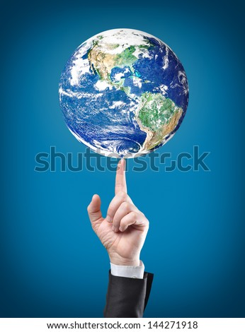 earth globe on top on businessman finger.Elements of this image furnished by NASA - stock photo