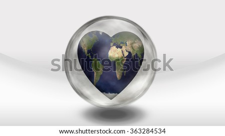 Earth Heart in glass container - stock photo