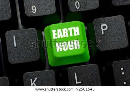 earth hour on green and black keyboard button - stock photo