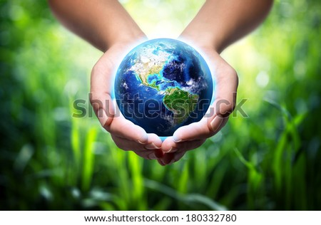 earth in hands - environment concept  - Usa, elements of this image furnished by NASA - stock photo