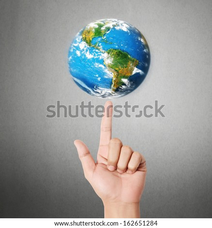 """earth in human the hand """"Elements of this image furnished by NASA""""  - stock photo"""