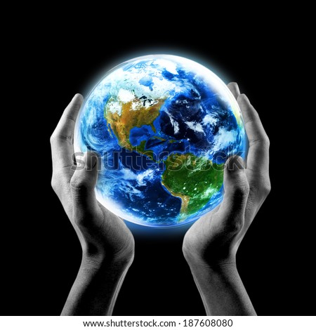 Earth in your hands, Saving Earth concept, Hands holding Earth with a black background. Elements of this image furnished by NASA  - stock photo