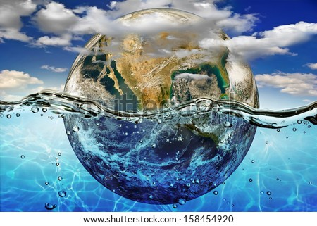 """Earth is immersed in water, among the clouds against the sky.""""Elements of this image furnished by NASA"""" - stock photo"""