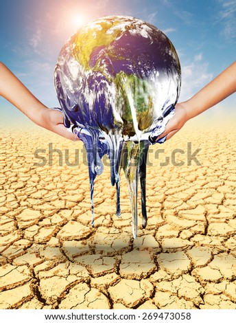 Earth melt in two hand on soil cracked .Earth day concept.Elements of this image furnished by NASA - stock photo