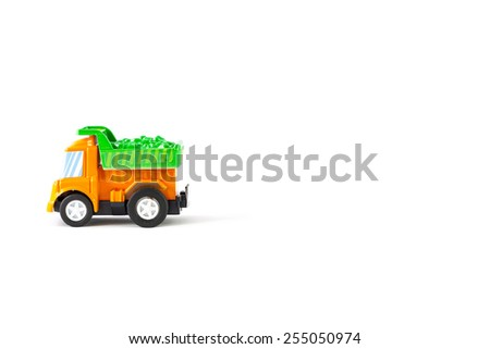 Earth moving toy. Orange and Green truck. - stock photo